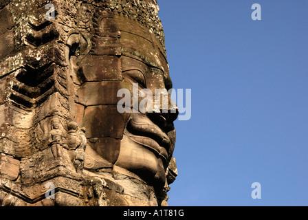 Stone Face on The Bayon Temple,  Angkor Thom, Cambodia, Asia - Stock Photo