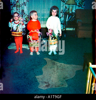 1950's Family Retro Photo,  Children Holding Easter Baskets at Home in Living Room, Vintage - Stock Photo