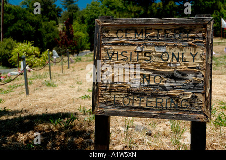 Weathered sign says 'cemetery visits only no loitering' at Pioneer Cemetery Julian California USA - Stock Photo
