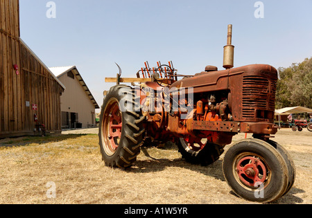 Old red tractor Antique Gas and Steam Engine Museum Vista California USA - Stock Photo