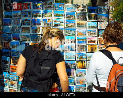 Two young travellers looking at postcards in Sultanahmet Park in Istanbul - Stock Photo
