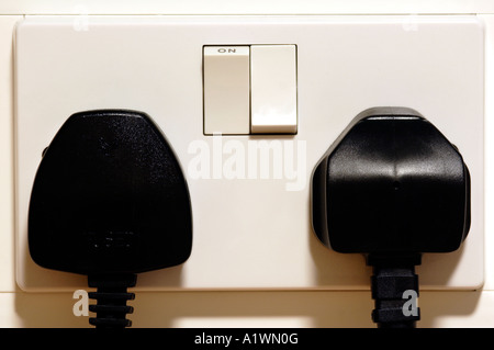 Mains power socket with plug - Stock Photo
