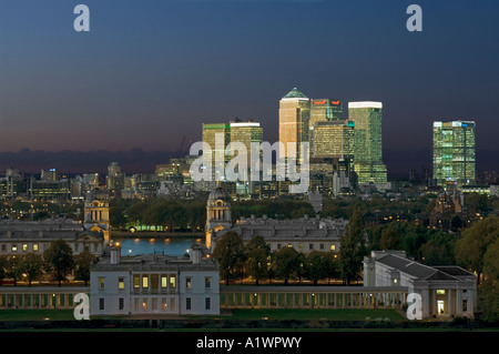 Canary Wharf from Greenwich Park with the Old Royal Naval College and Queens House in the foreground at sunset, - Stock Photo
