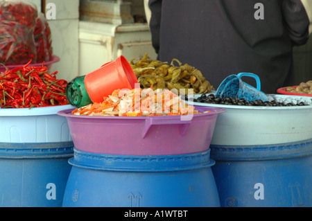 Bazaar on the medina of Sousse city in Tunisia. vegetables in barrels. - Stock Photo