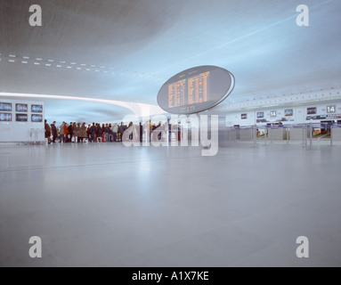 Travelers waiting in line at terminal 2E at Paris Charles de Gaulle airport, Paris, France. - Stock Photo