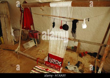Machine to making carpets inside the troglodytes house near Matmata town in Tunisia - Stock Photo