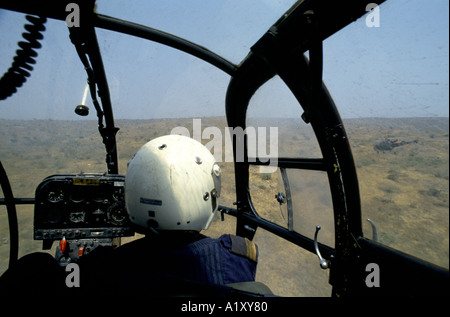ANGOLA CIVIL WAR AUG 1993 AERIAL VIEW FROM THE BACK OF A HELICOPTER WITH THE PILOT - Stock Photo