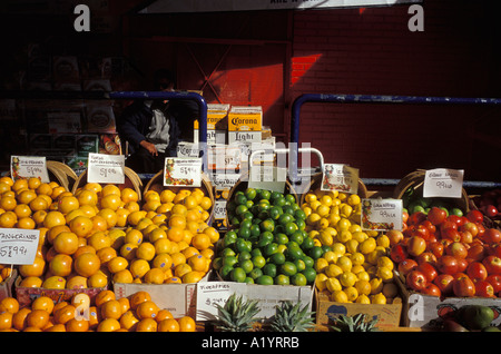 outdoor outside farmers market fruit vegetables oranges lime apples pineapple color colorful colourful Bon Appetit - Stock Photo