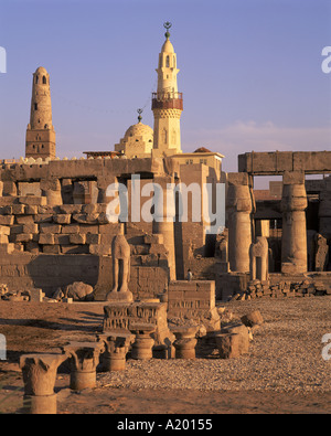 Ruins of the Luxor Temple and the minaret of the Abu el Haggag Mosque built in the middle Luxor Thebes Egypt Africa - Stock Photo
