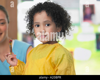 Girl painting in art class, portrait - Stock Photo