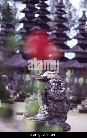 A stone god guards the entrance to the 17th century royal temple complex of Pura Taman Ayun at Mengwi in Bali - Stock Photo