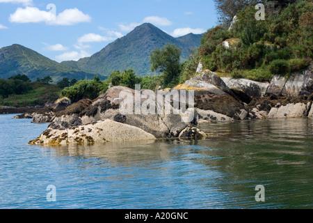 Rocks & Caha Mountains, from the Ferry to Ilnacullin Gardens, Garinish Island, near Glengarriff, County West Cork, - Stock Photo