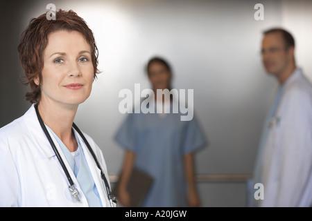 Doctor in Elevator, portrait - Stock Photo