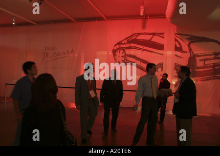 Brazilians enjoy a champagne reception to launch the new Citroen Xsara Picasso car , Sao Paulo, Brazil - Stock Photo