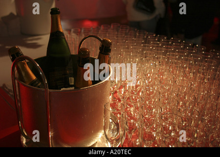 Champagne in a bucket of ice, with glasses at a car launch, Brazil. - Stock Photo