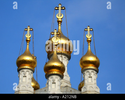 Golden domes of beautiful Russian Orthodox Church on a sunny day against blue sky, Geneva, Switzerland - Stock Photo