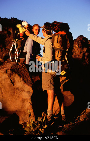 A family hiking at sunset on Mount Judah in the California Sierras near Truckee California - Stock Photo