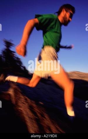 A blurry runner at sunset in the Yosemite high country - Stock Photo
