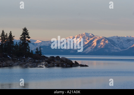 Lake Tahoe and Mt Tallac at dawn from the east shore - Stock Photo