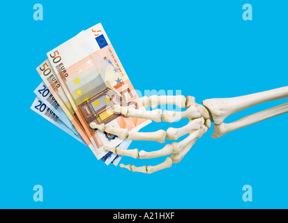 human skeleton left hand holding roll of fifty 50 pound notes, Skeleton