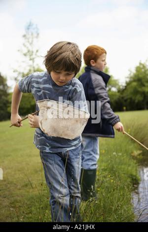 Boys Fishing in Pond - Stock Photo