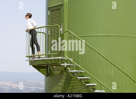 Woman on Wind Turbine Platform - Stock Photo