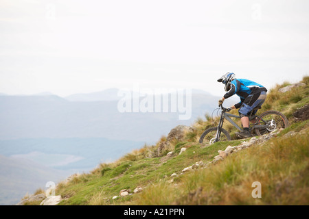 Man Mountain Biking down Hill, Aonach Mor, Scotland - Stock Photo