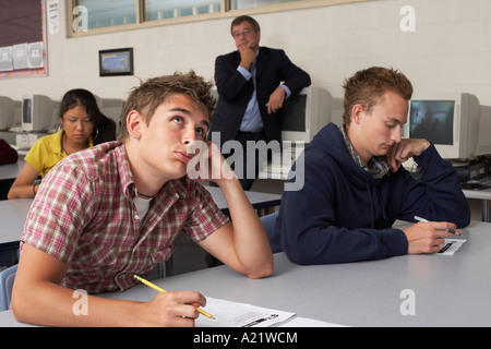 Teacher Watching Students Taking Test - Stock Photo