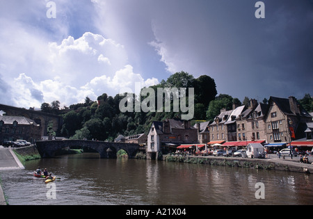 Canoeists on the River Rance beside the old port at Dinan, Brittany, France - Stock Photo