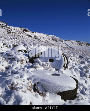 Abandoned Millstones beneath Stanage Edge Peak District National Park Derbyshire - Stock Photo