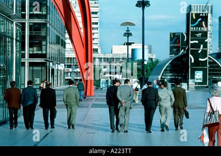 Paris France, 'La Défense Business Center' Business Men Walking in Line Busy Street Scene - Stock Photo