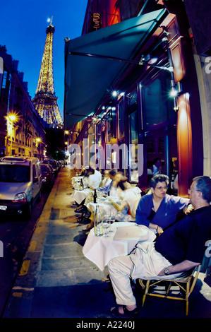 Romantic PARIS France, American Tourist  Couple on Sidewalk Terrace of French Bistro Restaurant 'Au Bon Accueil' - Stock Photo