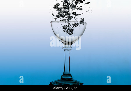 air bubbles escaping from submerged wine glass - Stock Photo