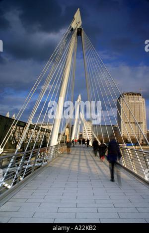 PEOPLE ON JUBILEE BRIDGE London England - Stock Photo