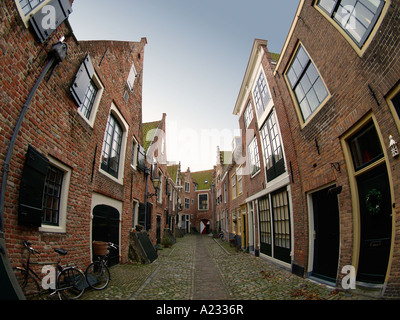 Beautifully restored traditional 18th century homes in a very narrow street in Middelburg Zeeland the Netherlands - Stock Photo