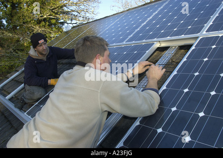 Installing photo voltaic cells on a house roof in South Devon England 5kw installed capacity - Stock Photo