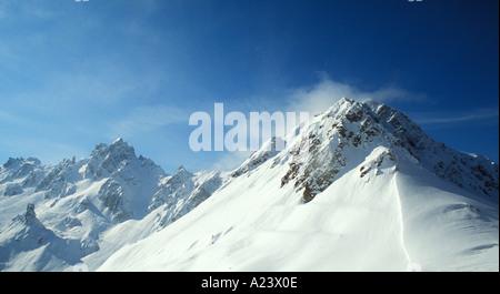 La Tania Courchevel ski slopes in mountains of the Trois Vallees Three Valleys ski region of French Alps France - Stock Photo