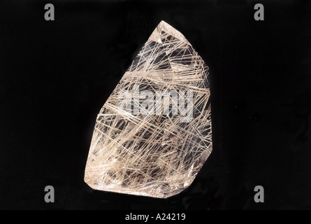 Rutilated Quartz. These stones are clear with metallic golden rutile. They are found in cooper or blue/grey colours. - Stock Photo