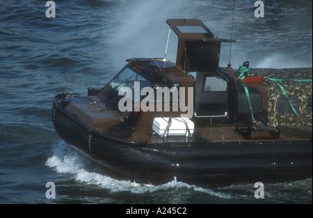 British Royal Marines hovercraft or LCACL landing craft air cushion light Portsmouth Hampshire England Europe - Stock Photo