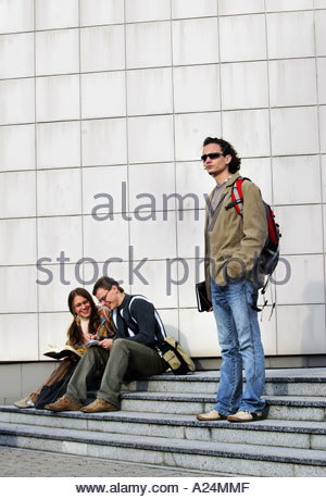 Couple Talking on Stairs Boy Waiting - Stock Photo