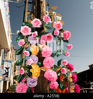 Paper and Plastic flowers for Christmas celebrations Mazatlan Mexico - Stock Photo