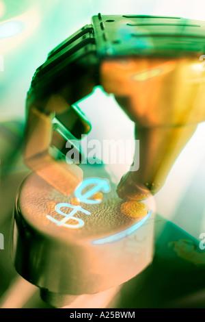 Robotic Hand on Typewriter Key. - Stock Photo