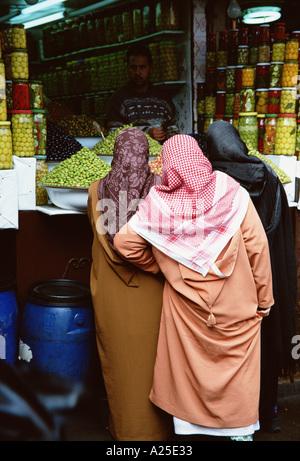 WOMEN AT SOUK MARRAKESH MOROCCO - Stock Photo