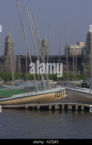 Boats sitting on the dock on the Charles River with the Longfellow bridge in the background - Stock Photo