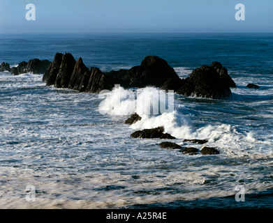 Heavy surf crashes against offshore rocks at Seal Rock State Park on the Oregon Coast - Stock Photo