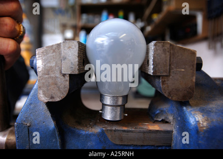 AN ELECTRICAL SHOP WORKSHOP WITH A LIGHT BULB IN A VICE UK - Stock Photo