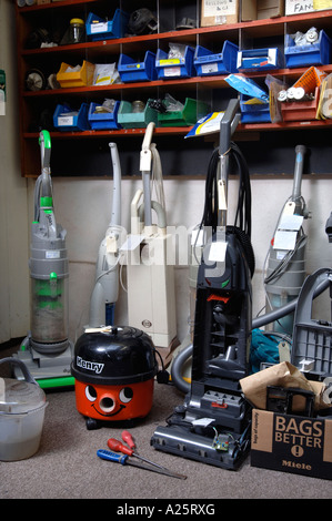 VACUUM CLEANERS AWAITING REPAIR IN A WORKSHOP UK - Stock Photo