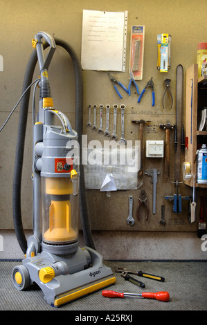 A DYSON DC04 VACUUM CLEANER AWAITING REPAIR IN A WORKSHOP UK - Stock Photo