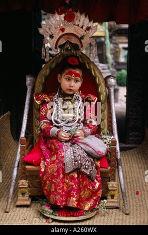 The LIVING GODDESS in her full regalia sits on her thrown during the Rato Machendranath Festival PATTAN NEPAL - Stock Photo