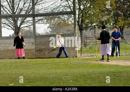 Children play baseball softball in schoolyard Amish lifestyle in and around Sugarcreek and Millersburg Ohio OH - Stock Photo